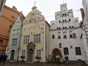 """Photo: These are """"the three brothers"""".  The white building is the oldest stone residential in Riga. The musicians played """"America"""" when they saw us coming."""