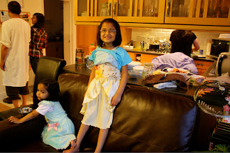 "Photo: Then she wanted me to take a picture of her ""Bahbie dress"" too. (I don't know how to write British accent but thats my guess.) That is baby Aminah next to her. All the girl cousins have matching nighties that they put on wherever they are at bed time!"