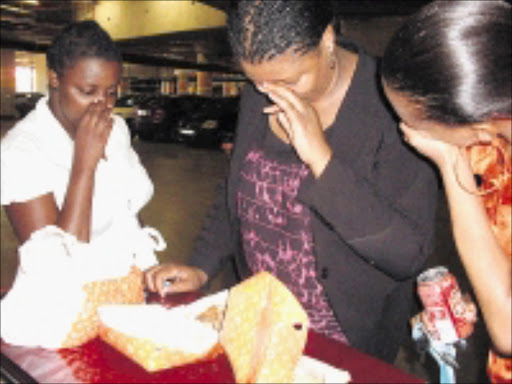 BAD SMELL: Rudzi Mashige, Puseletso Lepele and Lerato Mafora, who claim they bought chicken in Randburg only to find that it was rotten.   Cicra 2008. Pic. Sibongile Mashaba.  ©  Sowetan.