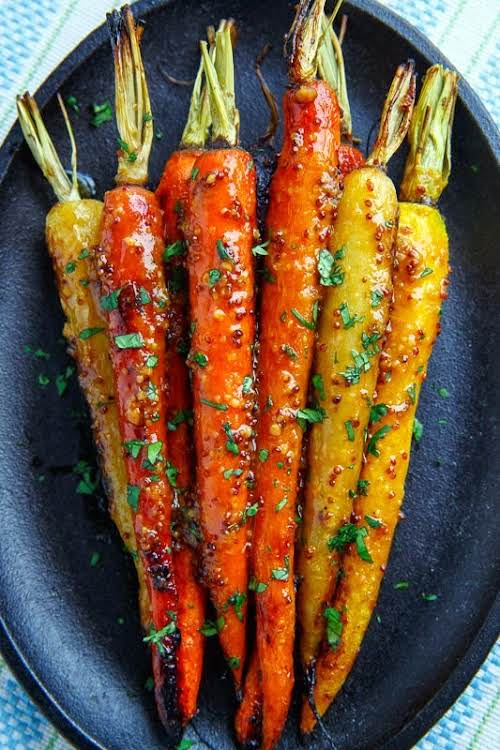 """Maple Dijon Roasted Carrots """"I like to toss the carrots in the..."""
