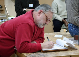 Photo: Newsletter Editor Mike Blake taking notes