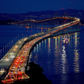 Light show on the San Rafael Bridge. by Robin Rawlings Wechsler - Buildings & Architecture Bridges & Suspended Structures ( lights, water, san francisco bay, night, travel, architecture, bridge )