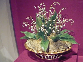 Photo: Imperial Lilies of the Valley Basket St. Petersburg, 1896.  Workmaster: attributed to August Wilhelm Holmström.  Fabergé's floral masterpiece and a favorite possession of the Tsarina Alexandra Feodorovna. Yellow and green gold, silver, nephrite, pearl, rose cut diamond.  Part of the Matilda Geddings Gray collection of Faberge and usually resides in the Cheekwood Botanical Garden and Museum of Art in Nashville, TN.  http://www.cheekwood.org/Art/Faberge.aspx