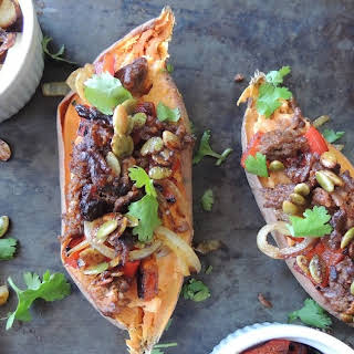 Sweet Potatoes Loaded with Chorizo, Caramelized Peppers and Onions, and Candied Pumpkin Seeds (Paleo).