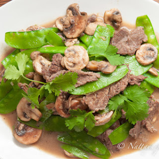 Stir-fried snow peas and mushrooms with Asian marinated flank steak