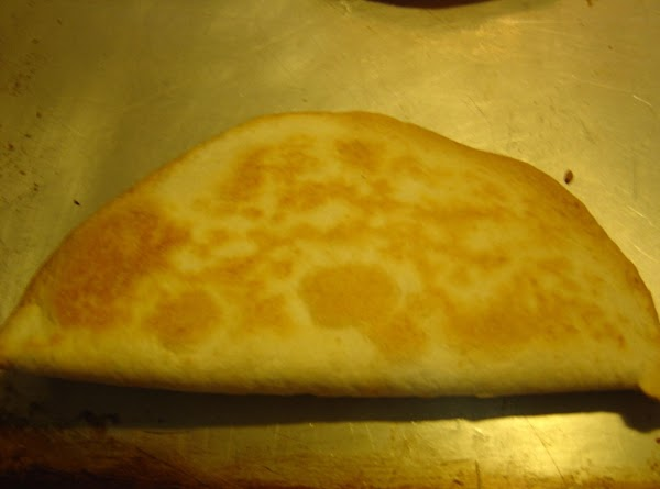 Bake in oven for 5 minutes. With tongs, fold tortilla in half, bake for...