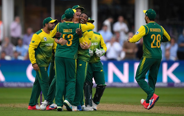 South Africa bowler Andile Phehlukwayo (c) is congratulated after bowling the final ball which England failed to hit the winning runs during the 2nd NatWest T20 International between England and South Africa  at The Cooper Associates County Ground on June 23, 2017 in Taunton, England.