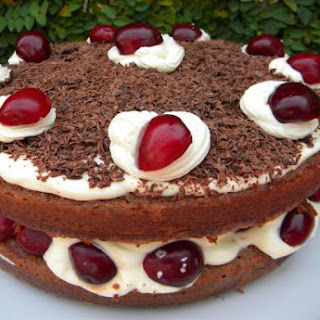 Chocolate Cake filled with Whipped Cream and Cherries.