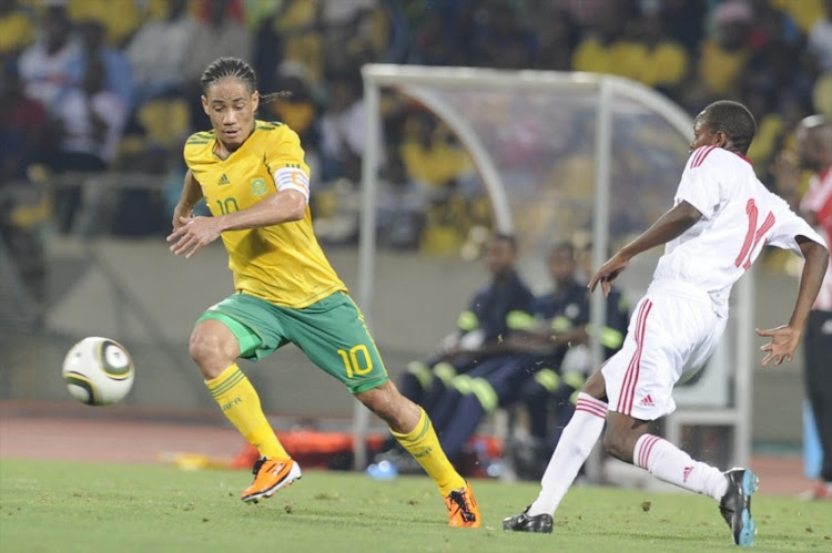 Steven Pienaar and David Gateri during the International friendly match between South Africa and Kenya at Royal Bafokeng Stadium on February 09, 2011 in Rustenburg.