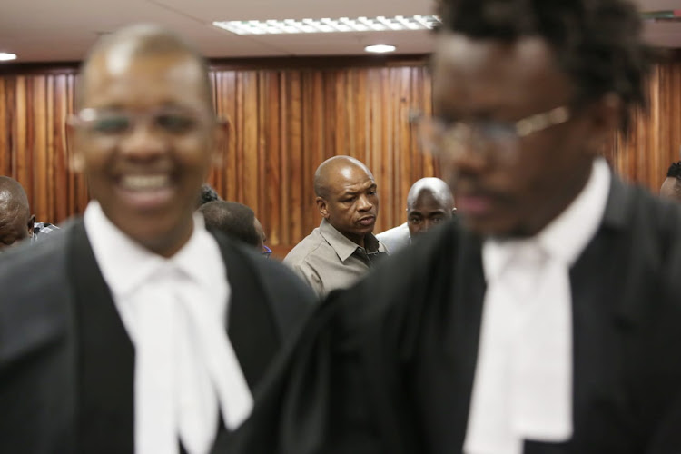 Supra Mahumapelo, centre, talks to journalists, while Advocate Dali Mpofu, left, and Advocate Tembeka Ngcukaitobi, right, share a lighthearted moment during a brief adjournment at the Johannesburg High Court.