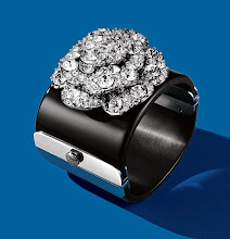 """Photo: CHANEL """"Camellia Festival"""" black resin cuff with strasse Camellia. $1,695. Italy. Main Floor. 212 872 8775"""
