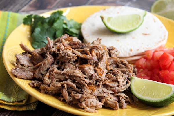 Mexican Pulled Pork Yucatan Style On A Plate With Tortillas.