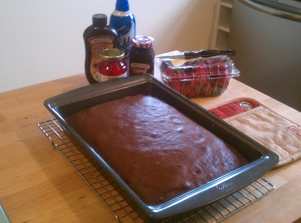 Grease a 13x9 baking pan and sprinkle with flour. Prepare your Cake mix per...