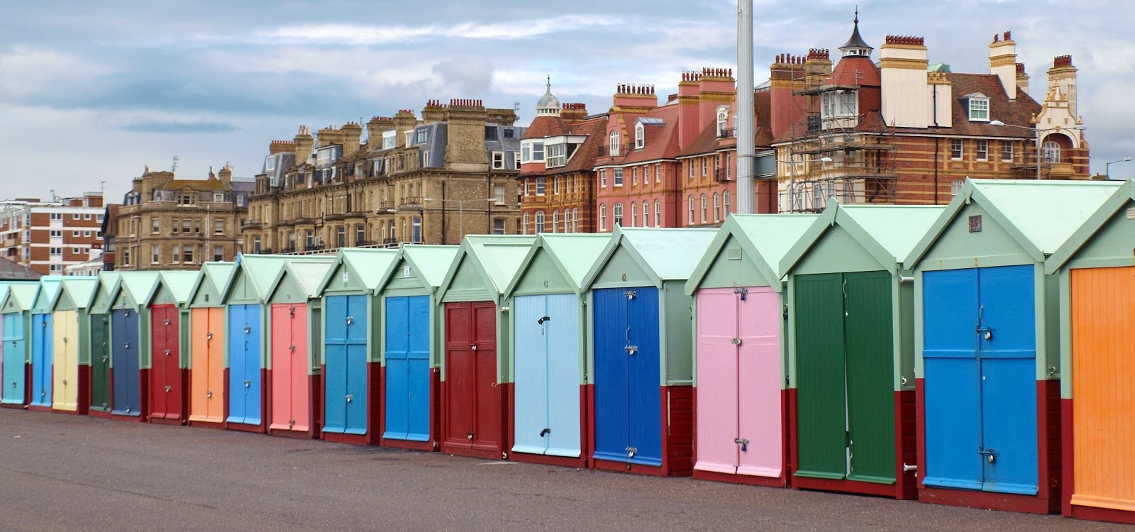 a few multicolored storage spaces in an english town