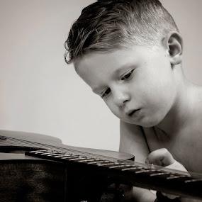 Love of music  by Stephanie Halley - Babies & Children Children Candids ( music, black and white, children, guitar )