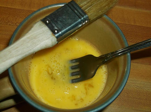 Brush with beaten egg; sprinkle with sugar if desired.