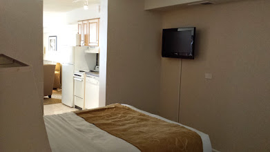 Photo: bedroom w/ TV included