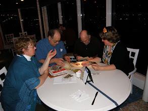 Photo: Sherna,  Sam, Jim and Bonnie looking through Samuel Hough Seniors memorbilia.