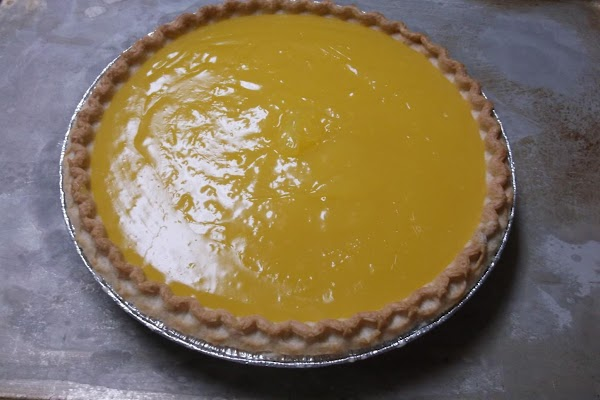 Pour into baked pie shell (on cookie sheet for ease of handling) and set...