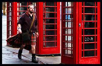 Photo: Funny Walking Kilt - The red telephone box, a telephone kiosk for a public telephone designed by Sir Giles Gilbert Scott, is a familiar sight on the streets of the United Kingdom, Malta, Bermuda and Gibraltar. Despite a reduction in their numbers in recent years, the traditional British red telephone box can still be seen in many places throughout the UK, and in current or former British colonies around the world. The colour red was chosen to make them easy to spot.  The red phone box is often seen as an iconic British symbol throughout the world. From Wikipedia, the free encyclopedia