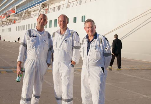 Chief engineer Peter Nilsson, right, with two other ship engineers standing aside the Viking Star.