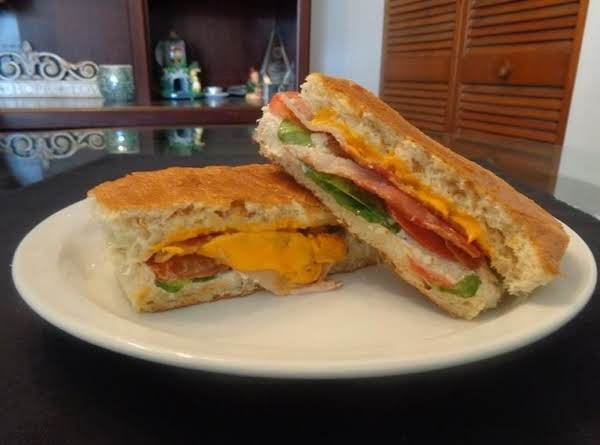 Grilled Cheese Sandwich With Onion Dip (onion, Cream Cheese And Parmesan Cheese), Bacon, Tomato, Spinach And Cheddar Cheese.