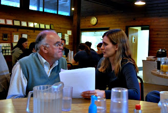 Photo: Martin Darby and Lauren Caldwell discuss the Workshop Schedule on Saturday morning.
