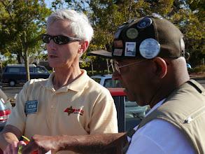 Photo: Michael John (KF6YRG) talking with John Rabold (KS6M).