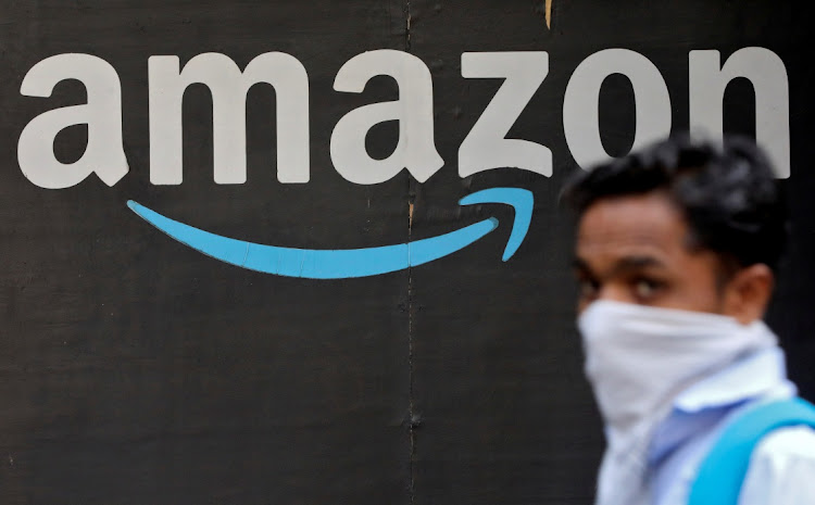 A man walks past an Amazon logo outside the company's collection point in Mumbai, India, March 19 2021. Picture: REUTERS/FRANCIS MASCARENHAS