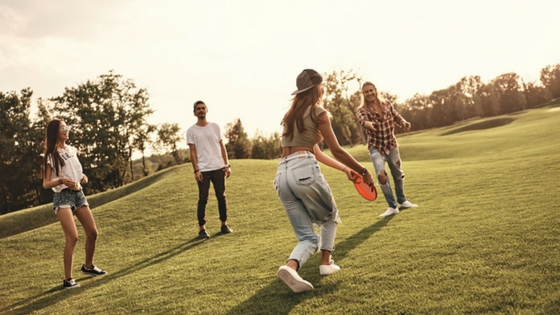 A group of friends playing Frisbee
