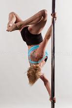 Photo: Vertical Pole Gymnastics - Twisted Pole-stand with Triangle Leg Line