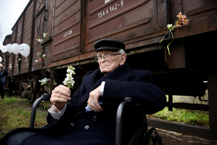 Moshe Haelion, a 93-year old Jewish survivor of the Holocaust, takes part in a memorial marking the 75th anniversary of the first deportation of Jews from Thessaloniki to Auschwitz, in Greece.
