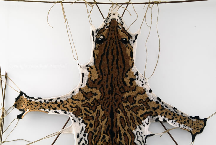 """Photo: #1 Ocelot   2009   46"""" x 24""""  (116cm x 60cm) Hand knitted textile. Interpretation of ocelot based on study of actual pelt at American Museum of Natural History. Female - collected from Brazil, 1930. Yarn, string, sticks.  (C) Ruth Marshall, 2009."""