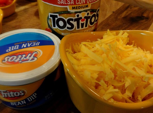 You will also need a jar of Tostitos salsa con queso, a salsa flavored...