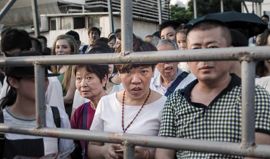 Stare by Wahan Shahbazian - People Street & Candids ( faces, woman, layers, stare, bars, closed, shanghai, gate, eyes, china )