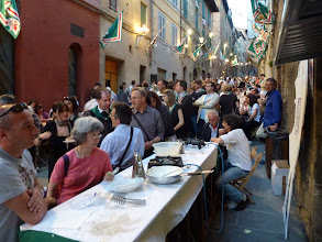 Photo: Back to the neighborhood festival for more to eat. Almost everyone, from young to old, are there by this time.