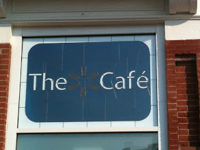 Photo: The sign for the Spark Cafe at the Walmart Visitor's Center