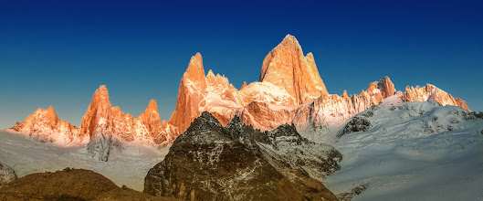 Photo: The Deep Blue Morning at Cerro Torre  I'd love to return to this place, but I'm afraid the weather would not be as clear and perfect. Many locals told me there is a 90% chance that these mighty peaks would be covered with clouds, so I felt very lucky to have everything so perfect. Surely, a return here would not be nearly as good… but maybe… just maybe… a return would have clouds, but in an awesome dramatic way.  You probably also know I'm not a fan of plain blue skies. But way up in the mountains, sometimes the sky on the opposite side of the sun is a deep atmospheric blue. I see it from planes a lot when dawn breaks. Maybe you have seen that color of blue too… and here it is again.