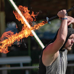 Colter by Duane Vosika - Digital Art Things ( performer, nebraska, fair, people, nikon, sword, omaha, firespinning, entertainer, outside, fire, action, man, sunny, male, photography )