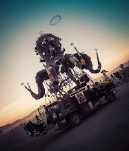 Photo: A massive steampunk octopus roams the desert while strange shapes float in the far distance...