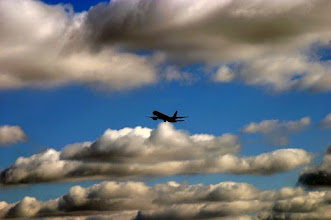 Photo: airplane silhouette into clouds