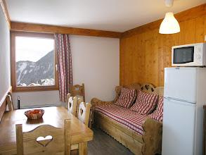 Photo: Coin cuisine et coin salon d'un appartement de la résidence