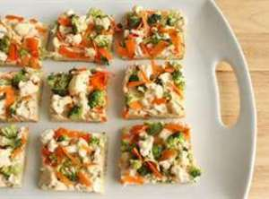 Serve cold. Can be cut in squares for appetizers or big pizza slices for...