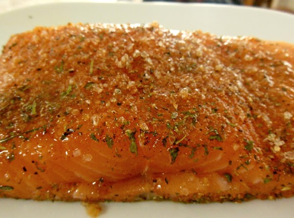 Drizzle olive oil on both sides of salmon pieces.  Rub chesapeake bay rub...