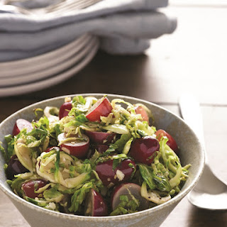 Shredded Brussels Sprouts Saute with Garlic, Ginger and Grapes