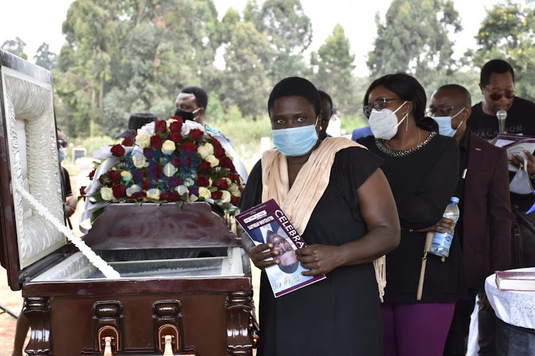 A mourner at Beloved's burial on July 23,2020.