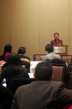 Photo: Anh Sawyer addressing APIC Student & Young Professional Breakfast