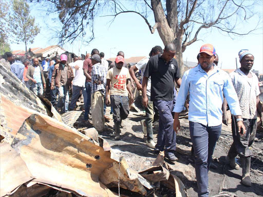 Lang'ata constituency member of Parliament Nixon Korir visits the area where houses were burnt./ EZEKIEL AMINGÁ