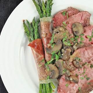 Beef with Prosciutto Wrapped Asparagus Bundles and Mushroom Sauce
