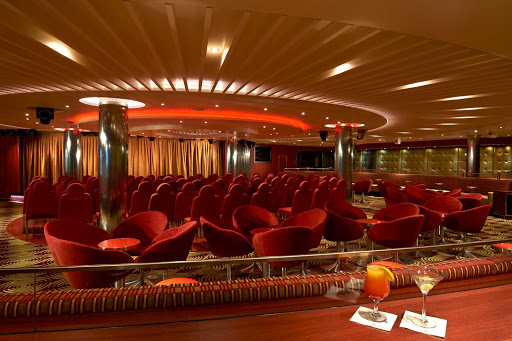 Gather at the Limelight Lounge for music and comedy aboard Carnival Panorama.
